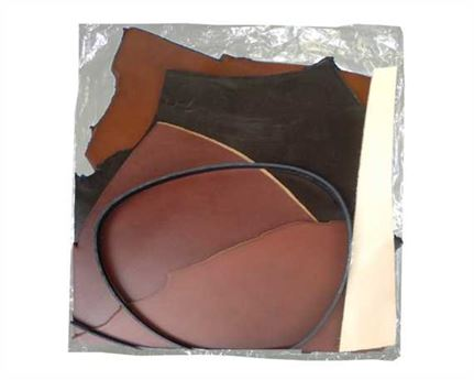 VEG TANNED BELT LEATHER OFFCUTS 3 TO 3.5mm IN A BAG APPROX 1.1KG